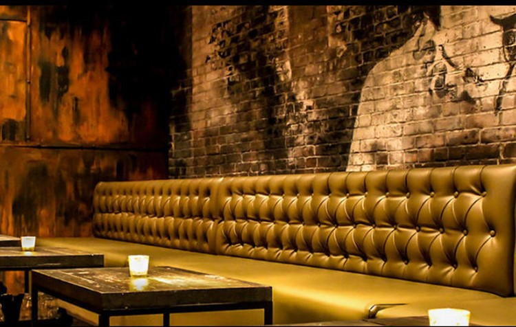 EFS SOCIAL CLUB nightclub Toronto corner view of lounge area gold couch and edgy walls
