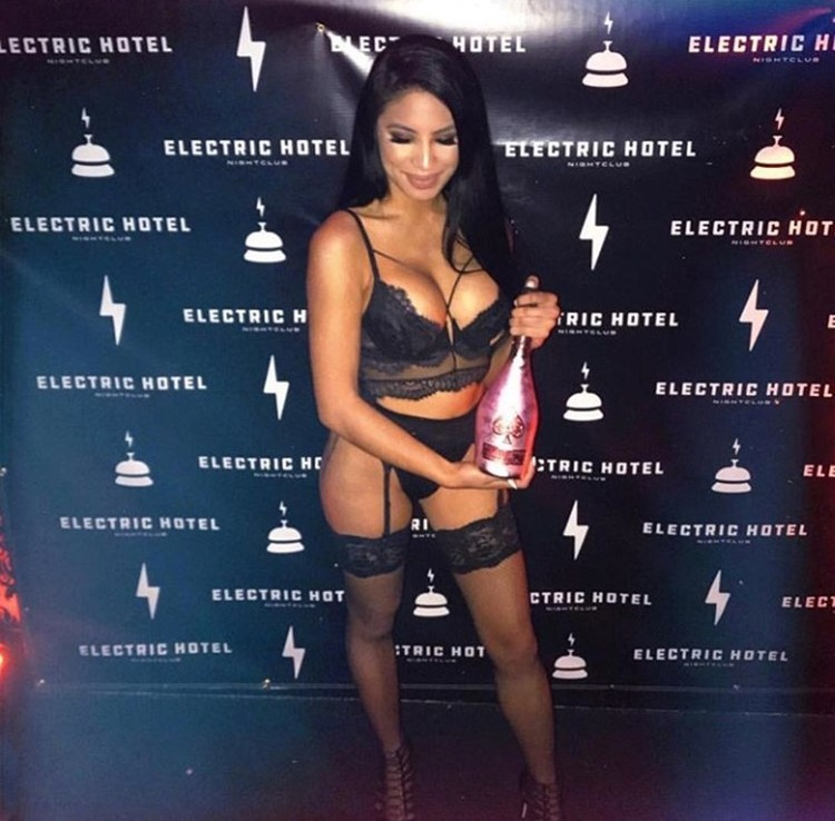 Electric Hotel nightclub Chicago sexy brunette girl dressed in sexy black lingerie holding bottle of champagne