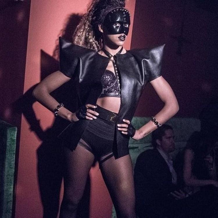 End nightclub Stockholm exotic dancer dressed in black leather