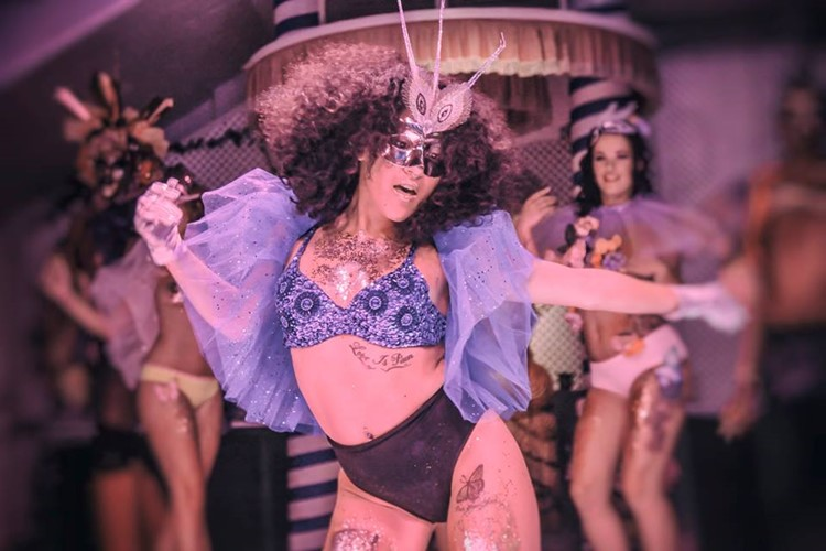 Es Paradis nightclub Ibiza exotic dancers dressed in swimsuits and face masks