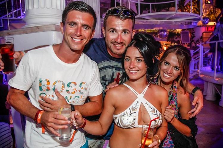 Es Paradis nightclub Ibiza two men and two girls drinking alcohol