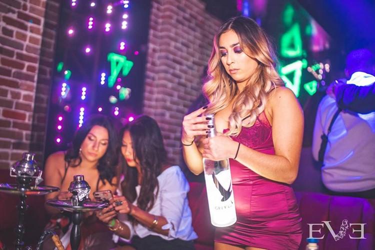 Eve Club nightclub Orlando party girls with big bottle of vodka Citroc
