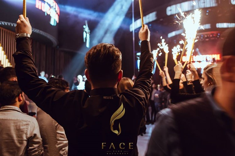 Face Club nightclub Bucharest party people drinking alcohol bottles celebrating