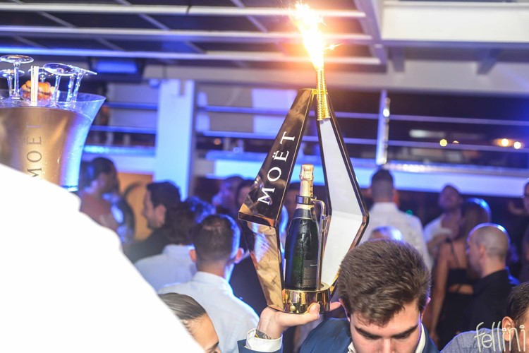 Fellini Club nightclub Milan party event show people partying drinks