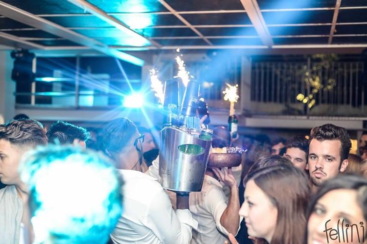 Fellini Club nightclub Milan girls dancing partying