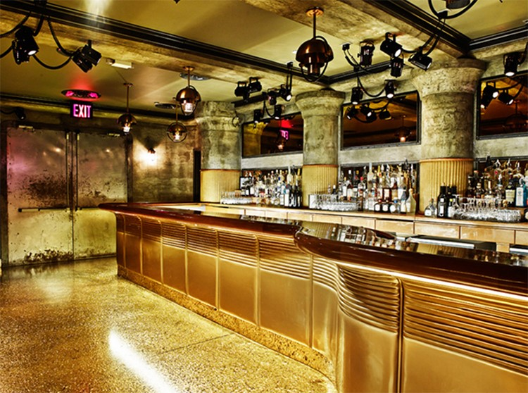 gilded lily nightclub new york luxury modern design interior golden furniture view of the bar with alcohol bottles