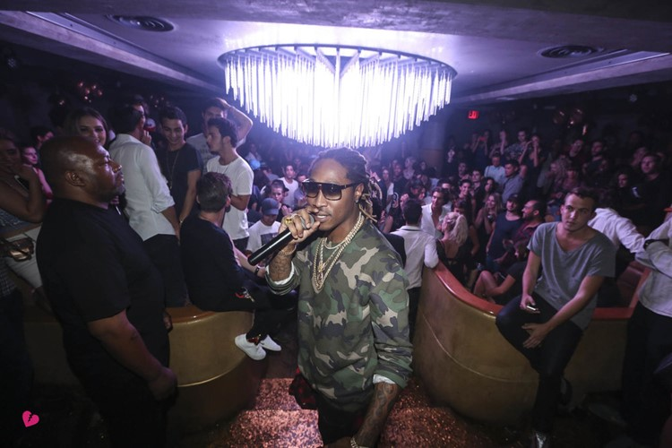 gilded lily nightclub new york black man celebrity famous rapper singing at a vip event party full crowd