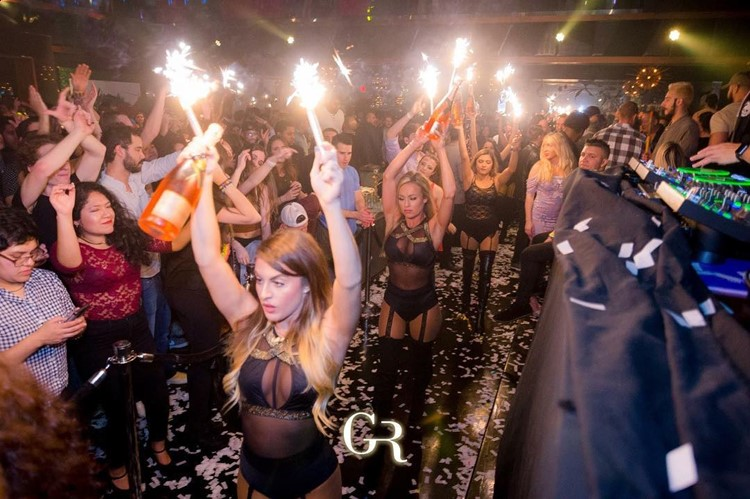 Gold Room Club nightclub Atlanta party sexy waitresses bring big bottles of alcohol vodka champagne people