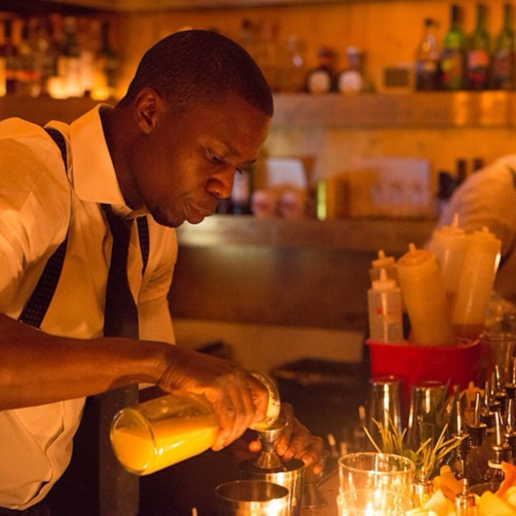 Goldbar nightclub New York City barman pouring drinks gold luxury design