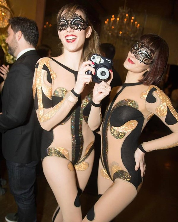 Goldbar nightclub New York City gold luxurious interior design two girls dressed in black and white costumes having fun
