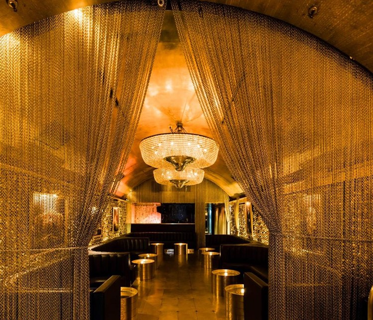 Goldbar nightclub New York City gold luxurious interior design chain curtain lounge area bar