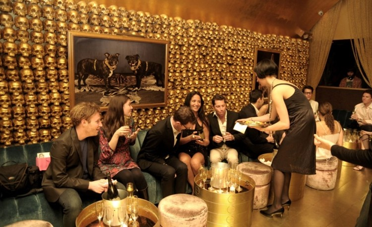 Goldbar nightclub New York City gold luxurious interior design people drinking waitress old school style