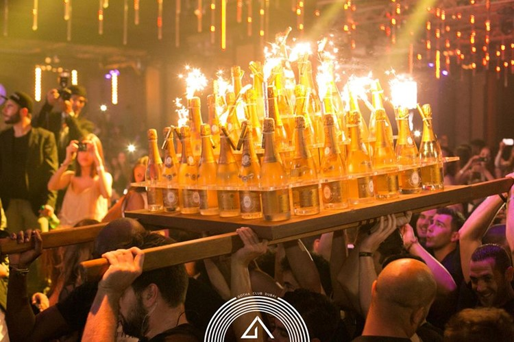 Gotha nightclub Dubai waiters bringing many bottles of alcohol