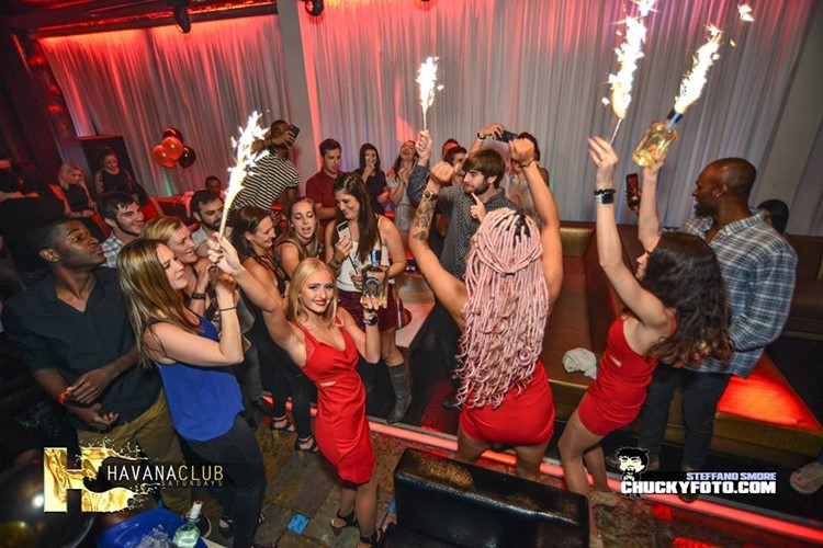 Havana Club nightclub Atlanta sexy waitresses in red mini dresses table service alcohol bottles vodka champagne