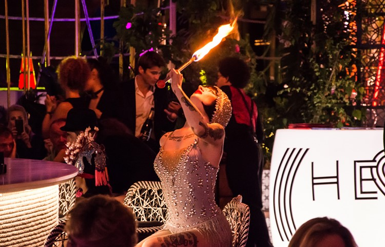 Heart nightclub Ibiza exotic dancer playing with fire dressed in 20s costume white pearls