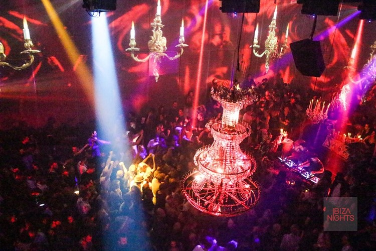Heart nightclub Ibiza crowd having fun at big event chandelier interior design