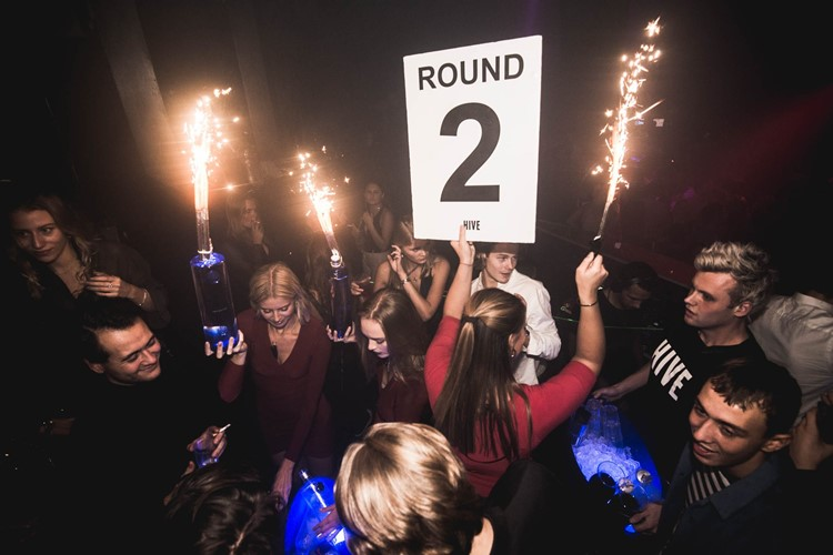 Hive Club nightclub Copenhagen party show celebrating table booking vodka bottles