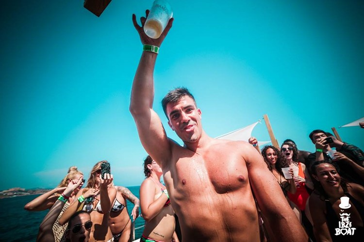 IBZ Boat Party Ibiza handsome guy having fun drinking dancing