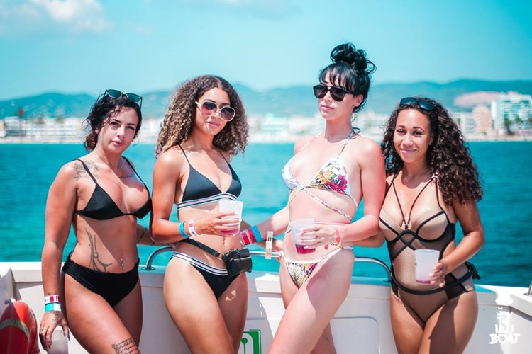 IBZ Boat Party Ibiza four girls in bikinis having fun taking pictures
