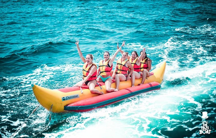 IBZ Boat Party Ibiza girls having fun on banana boat