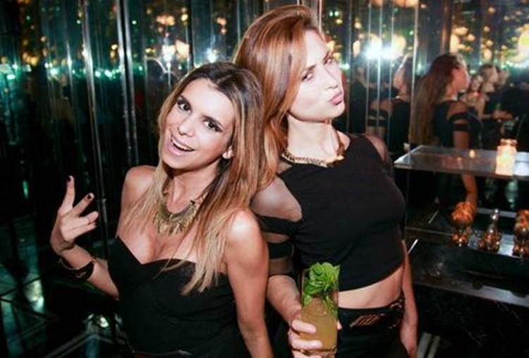 Jet nightclub Buenos Aires two brunette girls having fun drinking
