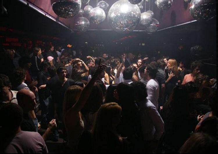 Jet nightclub Buenos Aires crowd dancing girls having fun partying disco balls
