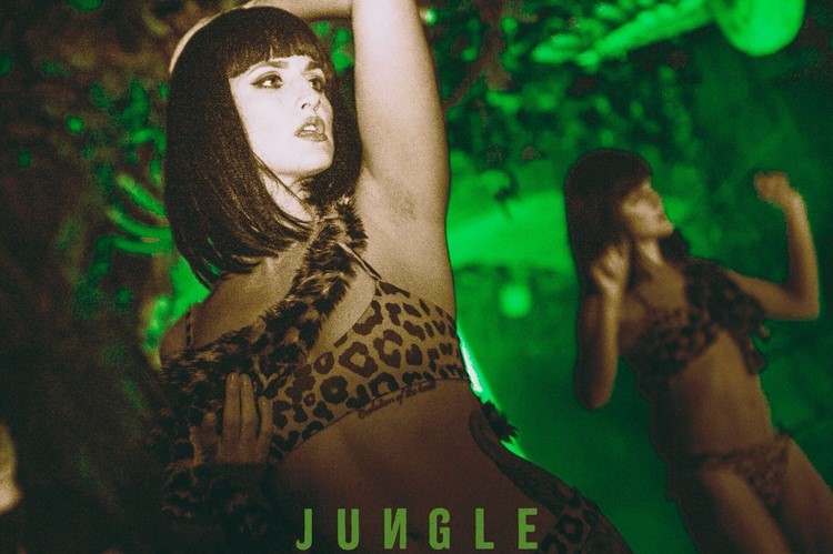 Lady in leopard patterned top at Jungle VIP nightclub in London