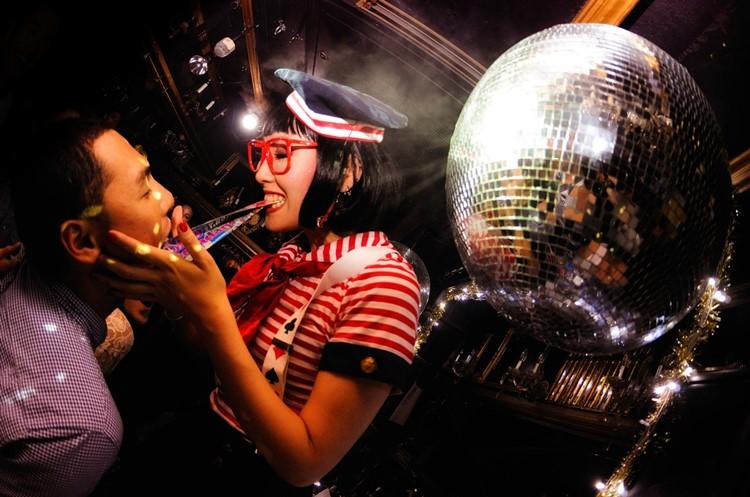 Kitsune nightclub Tokyo girl having fun disco ball