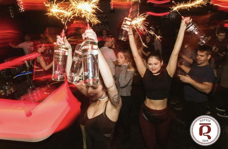 Le Rouge nightclub Montreal waitresses bringing bottles of alcohol vodka