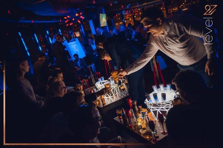 Level 27 Club nightclub Warsaw bar drinks people dancing