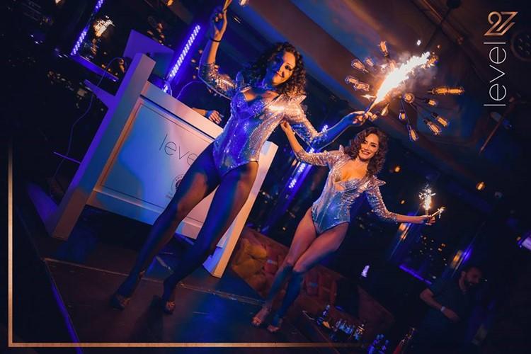 Level 27 Club nightclub Warsaw exotic dancer lights show in sexy costumes dance floor