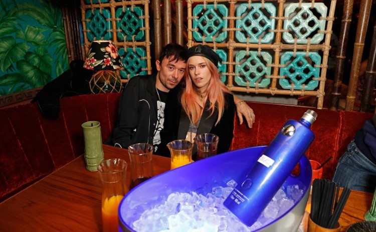 mahiki kensington nightclub london couple having drinks at a table booking with special expensive alcohol beautiful blonde woman