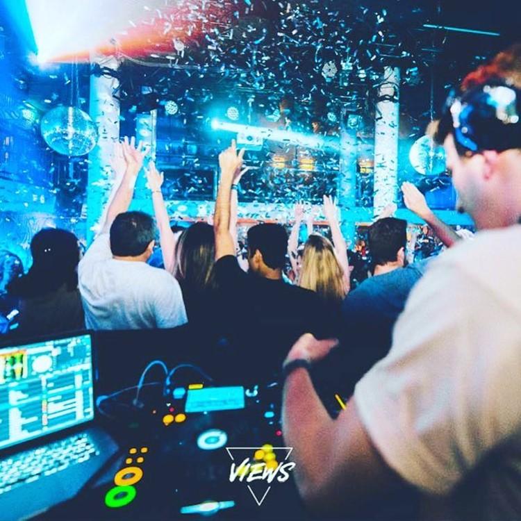 Mascotte Club nightclub Zurich dj mixing music people dancing drinking bar