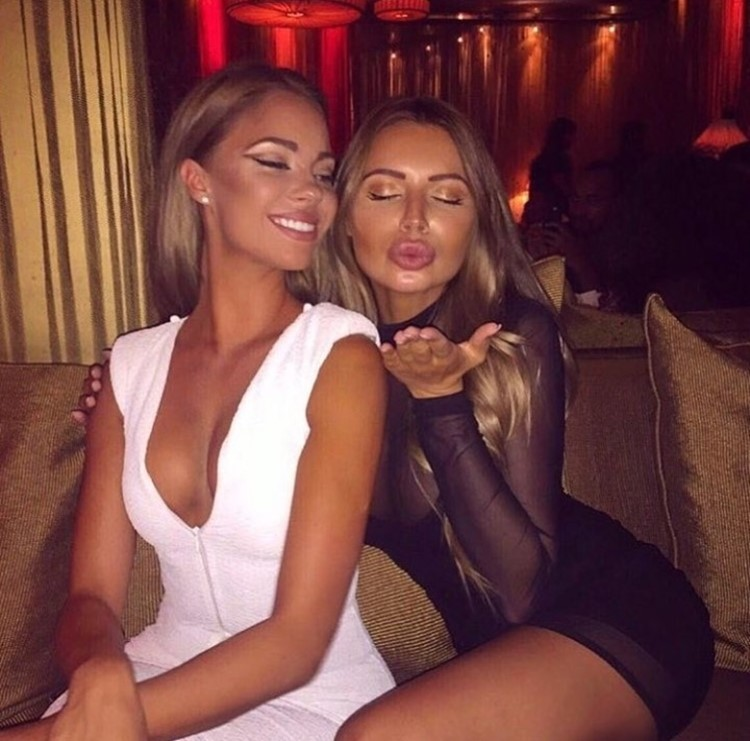 Matignon nightclub Paris beautiful blonde girls having fun blowing kiss dressed in white and black mini dresses