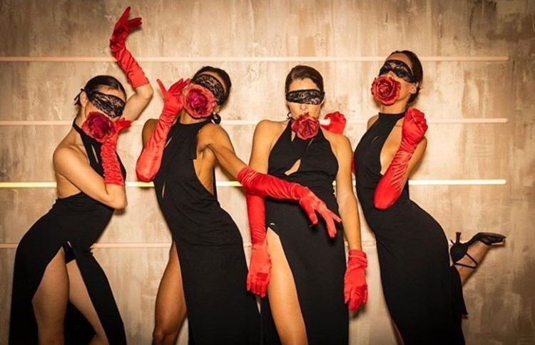Medusa nightclub Cannes four women dressed in black long dresses and red gloves