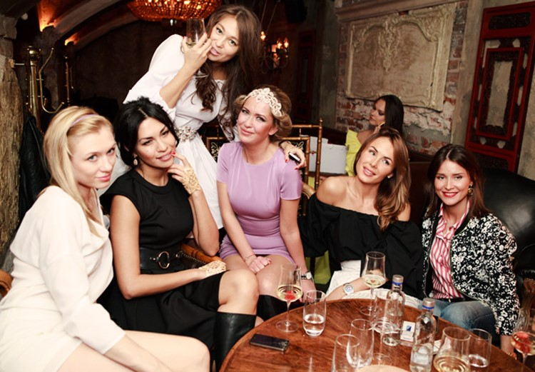 Mendeleev nightclub Moscow pretty women having drinks at the table