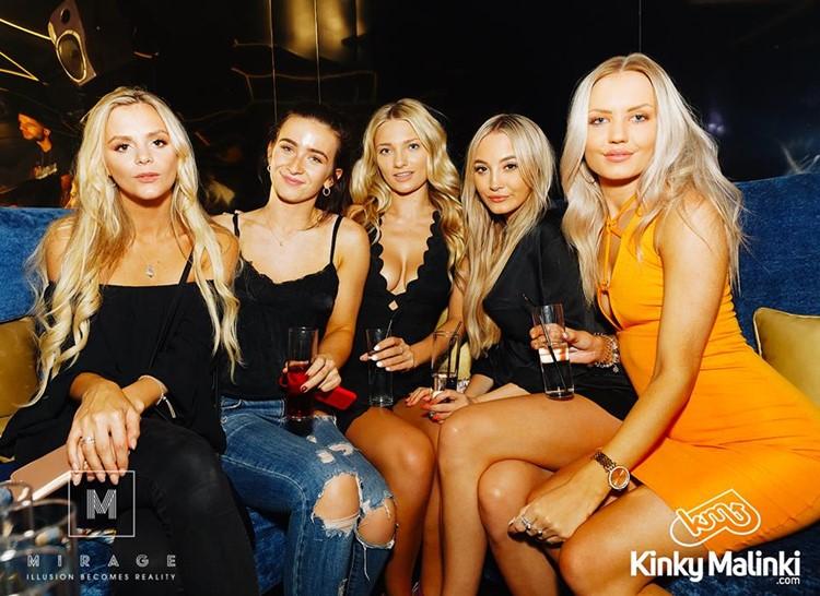 Mirage nightclub Marbella group of blonde girls dressed in sexy mini dresses having drinks