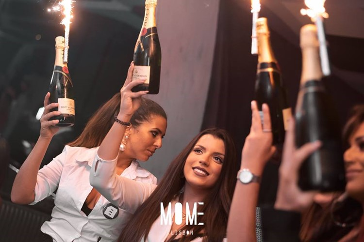 Mome nightclub Lisbon fun party girls big bottles of champagne vodka table service