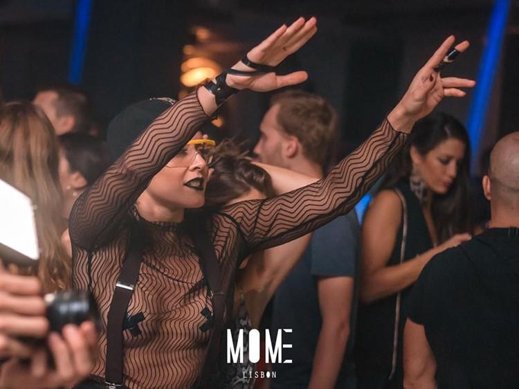 Mome nightclub Lisbon girl having fun dancing drinking