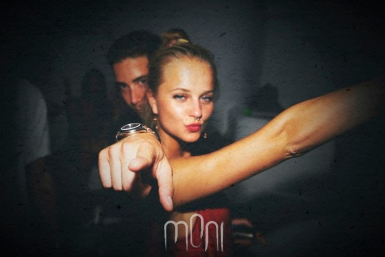 Moni nightclub Mykonos beautiful blonde girl with red lipstick and red dress having fun with a man