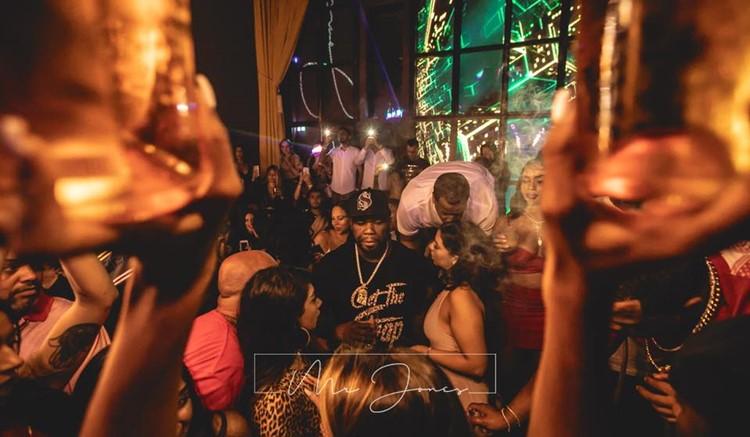 Mr Jones nightclub Miami 50 Cent celebrity show party singer drinking with girls