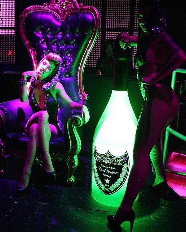 Mr Jones nightclub Miami sexy exotic dancer with big champagne bottle alcohol