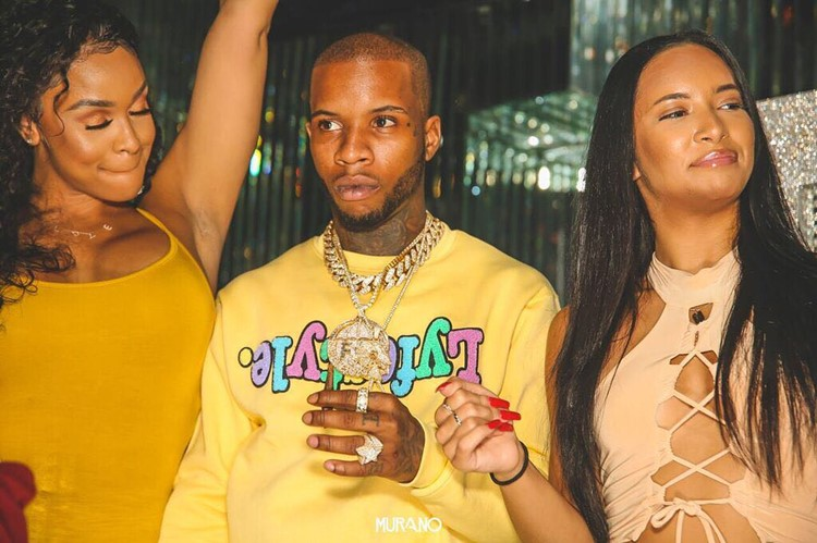 Murano nightclub Los Angeles famous artist rapper with two girls