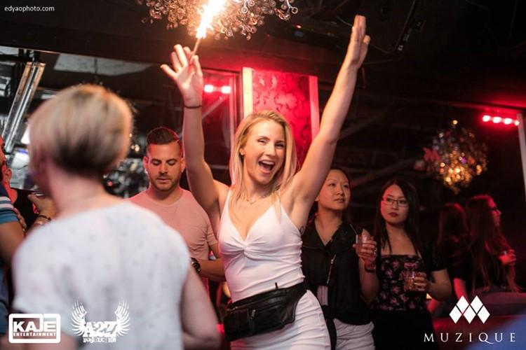 Muzique nightclub Montreal blonde girl having fun laughing