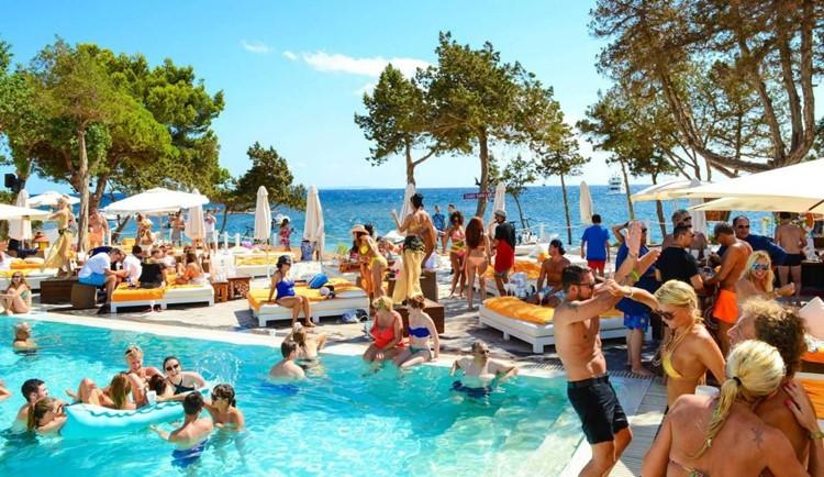 Nikki Beach beachclub Ibiza people swiming partying having fun drinking