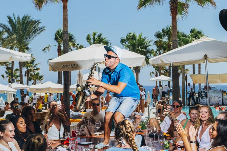 Nikki Beach beachclub Marbella saxophone musician playing concert for crowd