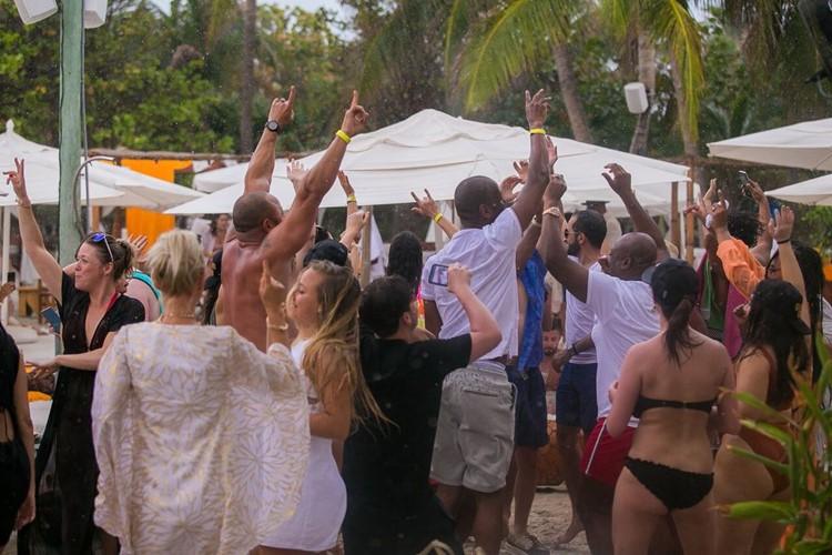 Nikki Beach beachclub Miami people having fun champagne shower