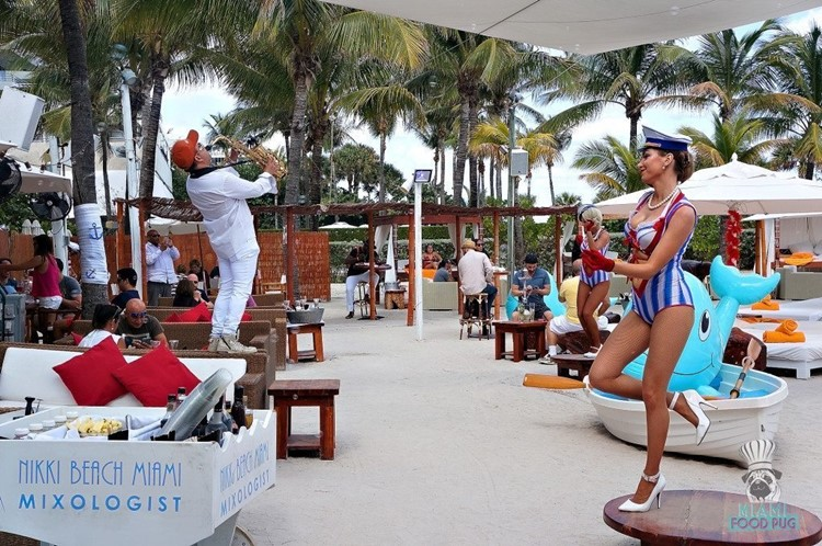 Nikki Beach beachclub Miami view of the lounge area people laying down chilling drinking