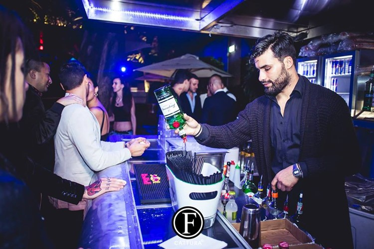 Old Fashion Club nightclub Milan party barman mixing drinks
