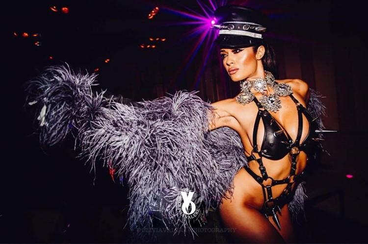 Olivia Valere nightclub Marbella beautiful dancer dressed in sexy leather bodysuit and fur jacket